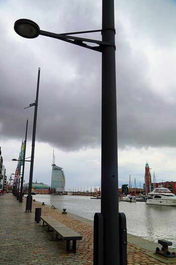 View of harbor against cloudy sky
