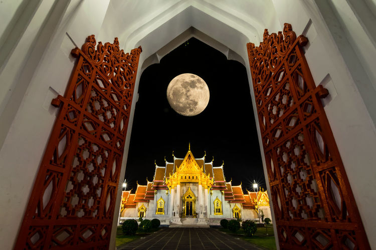 full moon over the beutiful temple Marble Temple Temple City Royalty Gold History Statue Architectural Column Place Of Worship Gold Colored Stupa