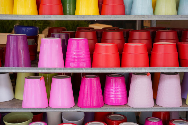 Collection Flowerpots For Sale Garden Equipment Gardening Gardening Equipment Gardening Shop Group Of Objects Large Group Of Objects Multi Colored Pots Shelf Side By Side Spring Springtime Store Store For Gardening Equipment Variation