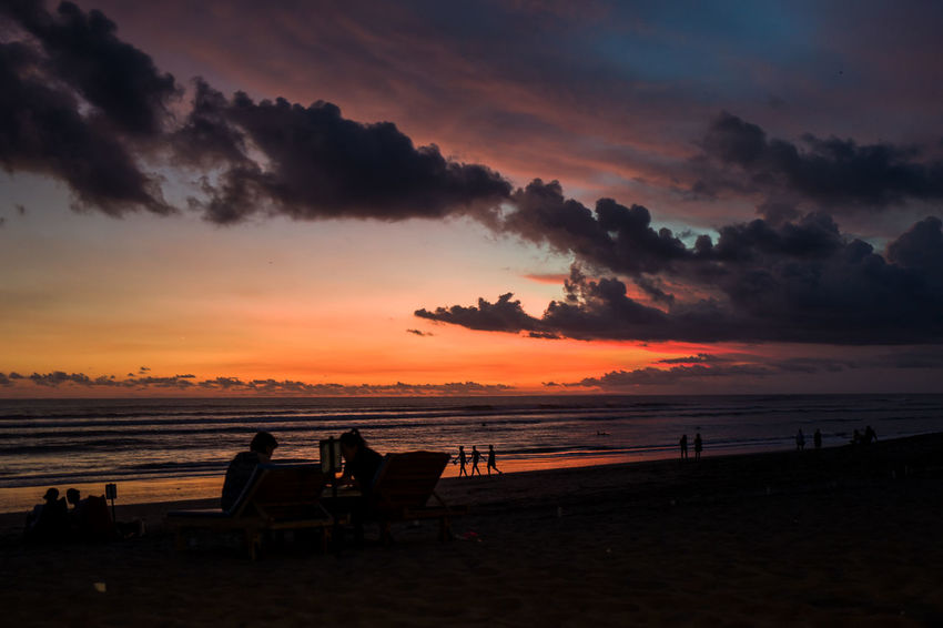 Sunset at Pantai Batu Bolong Beach in Canggu, Bali Beach Beauty In Nature Cloud - Sky Group Of People Horizon Horizon Over Water Idyllic Land Nature Orange Color Outdoors Scenics - Nature Sea Silhouette Sky Sunset Tranquil Scene Tranquility Water