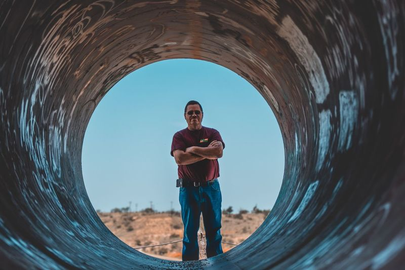 One Person Standing Front View Sky Tunnel Men Portrait Nature Full Length Looking At Camera Lifestyles Casual Clothing Leisure Activity Geometric Shape Circle Day Architecture Outdoors Shape