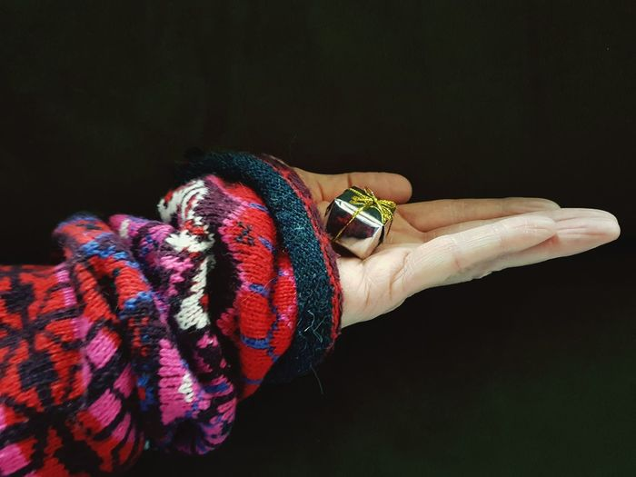 Human Hand Human Fingers Woman Wool Sweater Black Background Gift Small Gift Day Indoors  EyeEm Ready   Holiday Moments