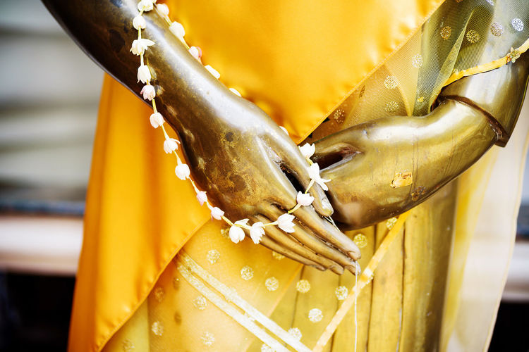 Close up hand of Golden buddha statue in the temple Thai Thailand Ancient Art ASIA Asian  Belief Buddha Buddhism Buddhist Close Up Culture Faith Gold Golden Hand Image Karma Meditation Mind  Peace Peaceful Religion Respect Sculpture Spirit Statue Symbol Temple Worship
