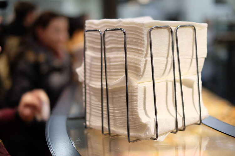 Stack of tissue papers on table in restaurant