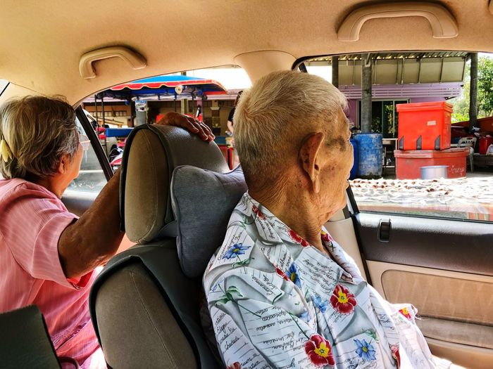 Grand parent are looking for their old friend. Grand Parents Vehicle Interior Transportation Mode Of Transportation Men Adult Travel Sitting Real People People Lifestyles Group Of People Women Car Casual Clothing