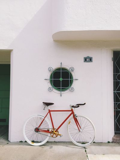 Red bicycle with white tires
