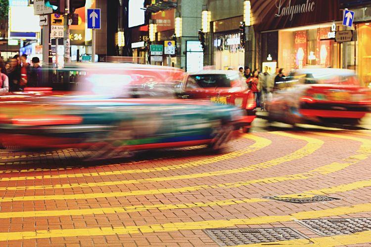 Blurred motion of illuminated city street at night