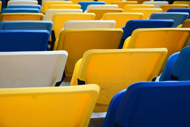 Paint The Town Yellow In A Row Chair Yellow No People Day Auditorium Seat Outdoors Stadium