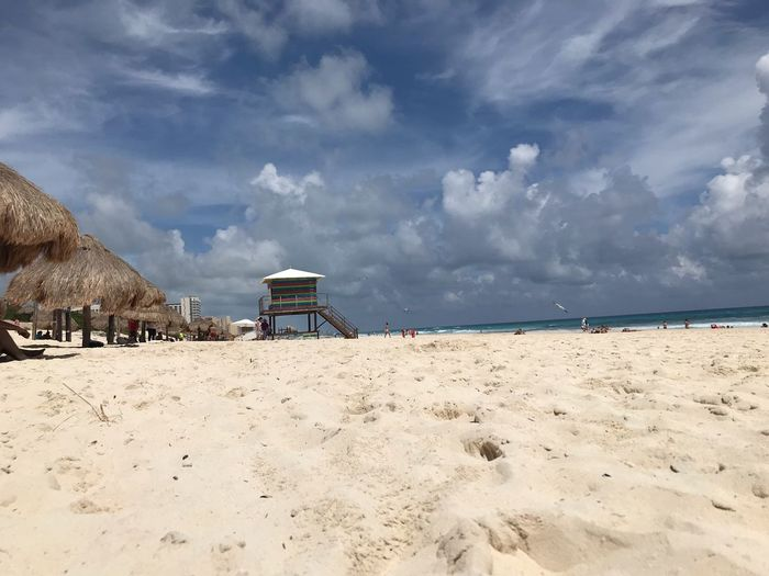 Sand Beach Sky Land Cloud - Sky Scenics - Nature Nature Horizon Over Water Tourism Non-urban Scene Trip Tranquil Scene Water Holiday Beauty In Nature Tranquility Sea Day Built Structure Outdoors