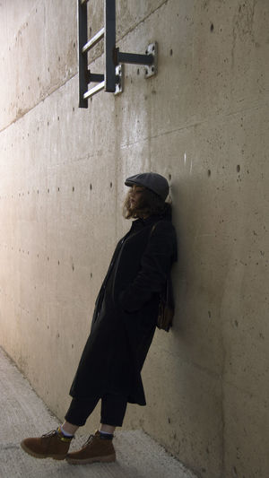 Full Length One Person Real People Clothing Side View Architecture Wall - Building Feature Lifestyles Building Adult Casual Clothing Leisure Activity Indoors  Social Issues Women Built Structure Concrete Sitting Depression - Sadness Day Contemplation The Week on EyeEm EyeEmNewHere EyeEm Best Shots My Best Photo