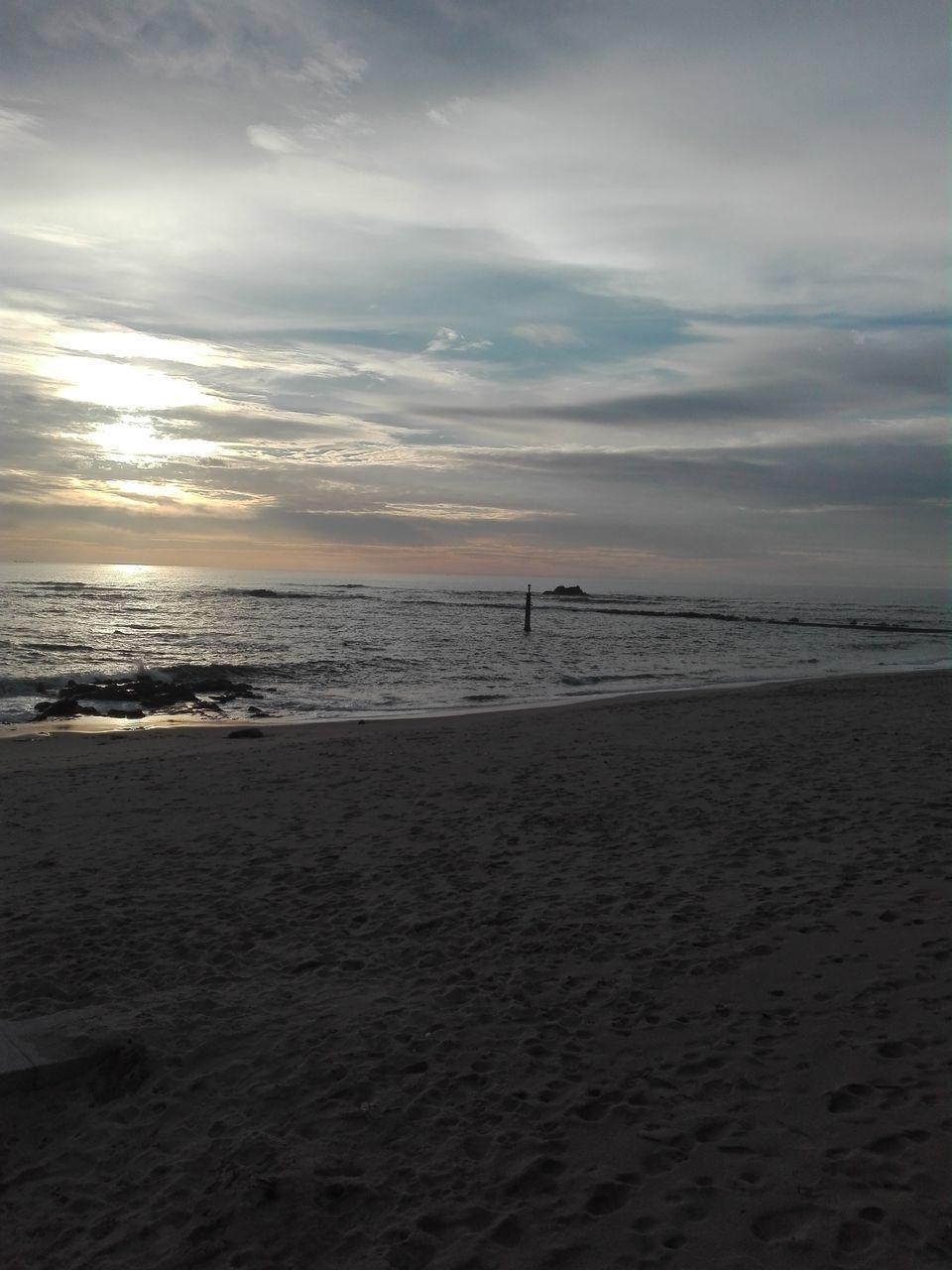 sea, beach, sand, water, horizon over water, sky, scenics, beauty in nature, nature, tranquility, cloud - sky, tranquil scene, sunset, idyllic, outdoors, vacations, wave, no people, day
