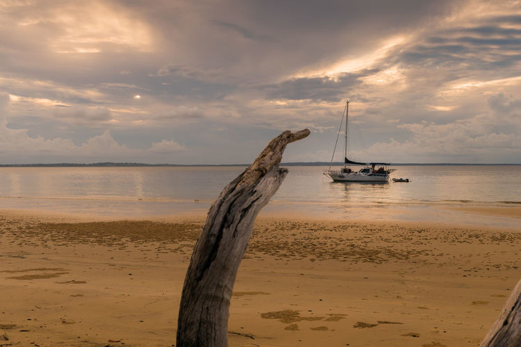 Sun going Down Beach Beauty In Nature Cloud - Sky Day Horizon Over Water Mode Of Transport Nature Nautical Vessel Outdoors Sand Scenics Sea Sky Sunset Tranquility Transportation Water