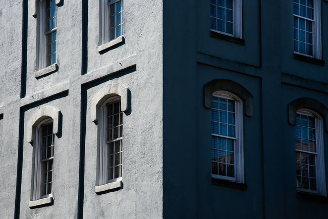 Building Exterior Window Built Structure Architecture Building Low Angle View No People Day Residential District Full Frame Glass - Material Backgrounds Outdoors City In A Row Arch Side By Side Symmetry