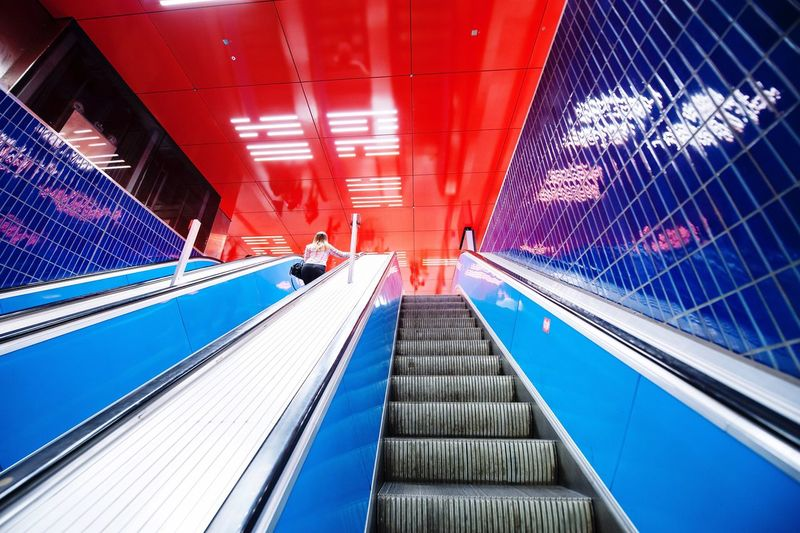 Low Angle View Of Escalators At Subway