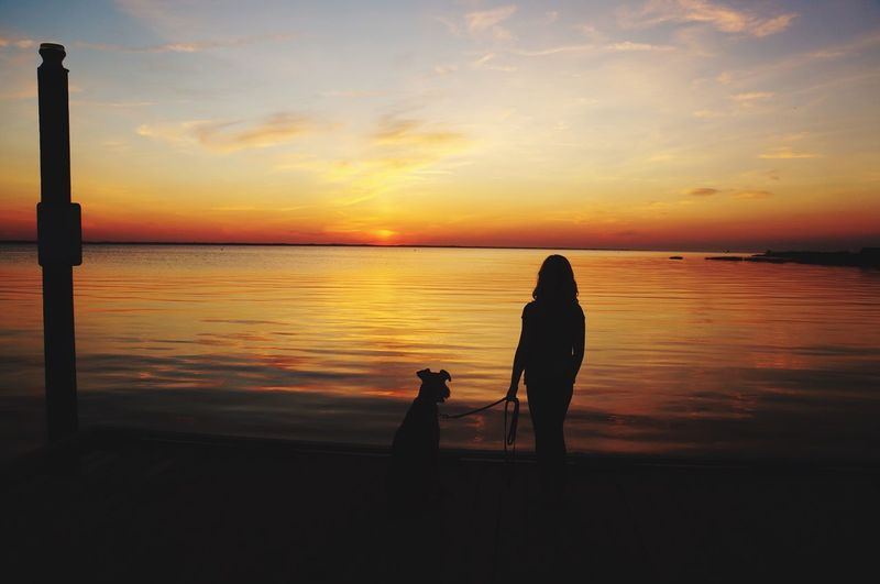 Sunset Sea Sky Nature Water Beauty In Nature Beach Standing Outdoors Real People Horizon Over Water Silhouette Sunset Scenics Reflection Togetherness Full Length Tranquil Scene Cloud - Sky Tranquility Leisure Activity First Eyeem Photo