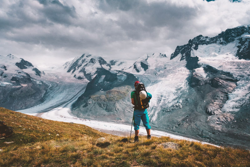 Monte Rosa Adventure Backpack Beauty In Nature Cloud - Sky Cold Temperature Full Length Hiker Hiking Leisure Activity Lifestyles Mountain Mountain Range Nature One Person Outdoors Real People Rear View Scenics Snow Standing Switzerland Walking Weather Winter Lost In The Landscape