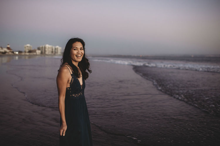 Portrait of woman standing on beach