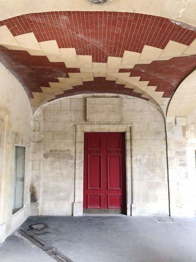 Doortrait Man Made Structure Man Made Red Arcade Tile Curve Lines And Shapes Lines LINE Pattern, Texture, Shape And Form Pattern Doorways Doorway Door Streetphotography Street Travel Destinations Travel Outdoors Paris Architecture Built Structure Entrance Door Building No People Day Closed Building Exterior Old My Best Photo The Mobile Photographer - 2019 EyeEm Awards The Architect - 2019 EyeEm Awards