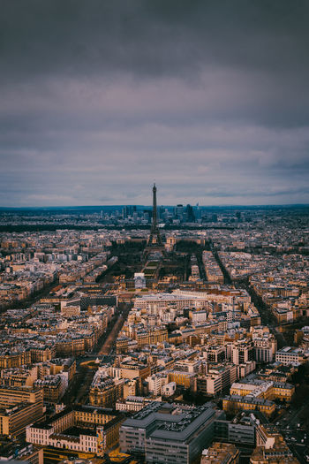 Distant view of eiffel tower amidst cityscape