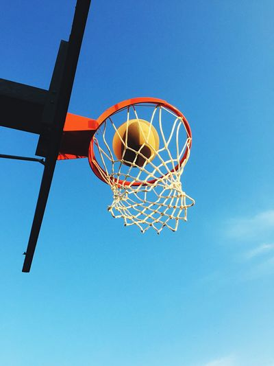 Playing basketball against sky Basketball Hoop Blue Basketball - Sport Low Angle View Making A Basket Sport Day Scoring Net - Sports Equipment Clear Sky Sky Outdoors No People Court Basketball Ball Win Leisure Games Basket Winner Sports Game Competition Freedom Low Angle View 10