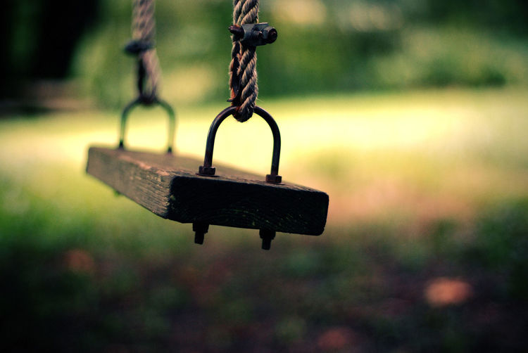 Close-up of swing at playground