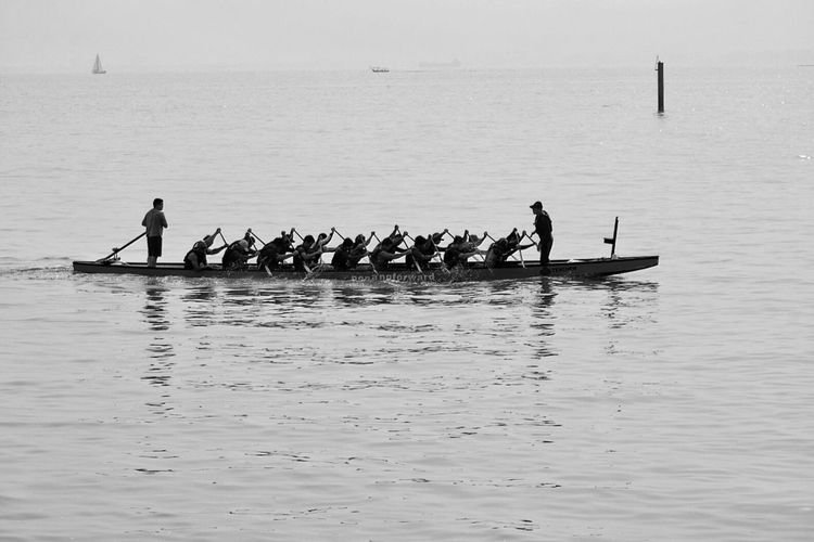 Feel The Journey Dragon Boat Oars In Water Penang Malaysia Penang Malaysia Ocean View Sea And Sky Rowing Paddle Working Together Team Crew Power Team Work Fine Art Photography Group Of People Water Splash Water Sea Sport Small Boat Monochrome Black And White Dragon Boats Oarsman Boat Water Sports Monochrome Photography