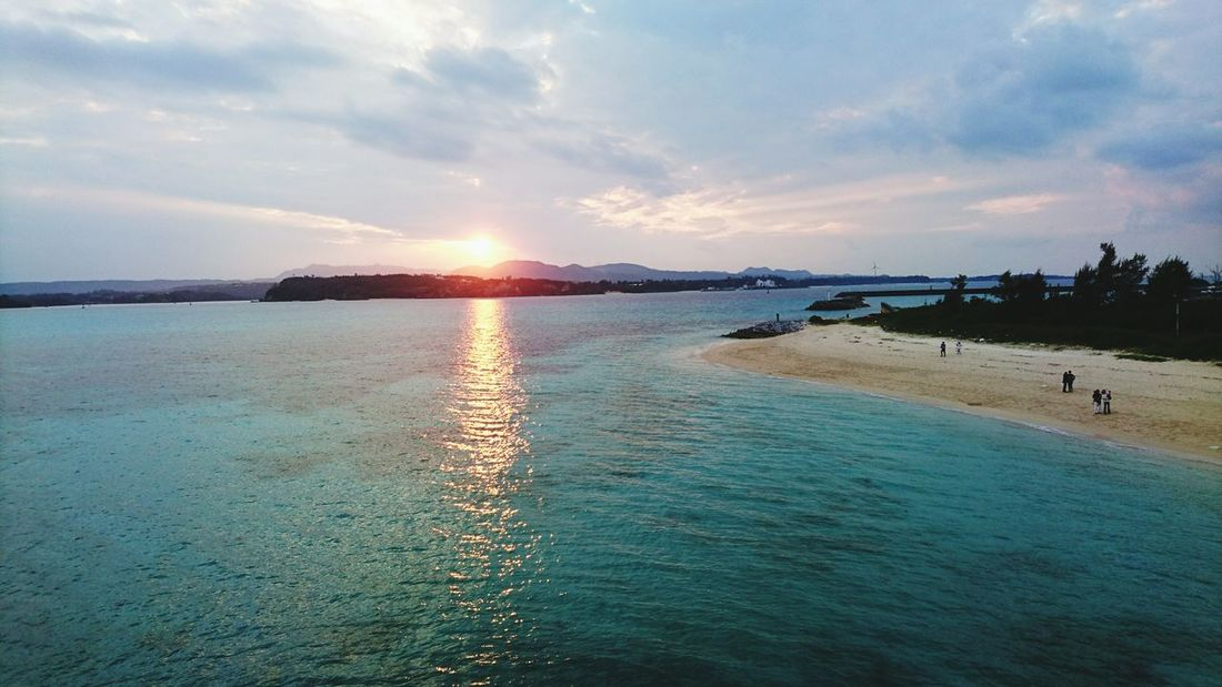 Kouri Island, Okinawa. Just in time to glimpse sunset above an ever-blue and ever-clear sea.Sea Reflection Beach Sunset Dramatic Sky Outdoors Vacations Beauty In Nature Travel Destinations Nature