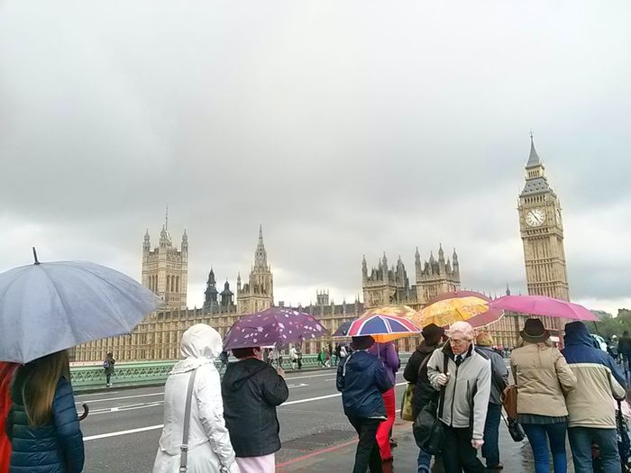 Travel Destinations Tourist Cultures City People Umbrellas Fog Walking Rain Rainy Days Tourism London England, UK England Street Photography Travel Bridge - Man Made Structure Tourist Attraction  Street City Pedestrians City Of London Miles Away