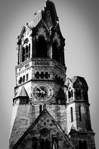 the church .... Architecture Berlin Blackandwhite Building Exterior Built Structure Church Clock Clock Tower Cross Kaiser-Wilhelm-Gedächtnis Kirche Kirche Low Angle View Outdoors Place Of Worship Religion Spirituality Tower Urbanphotography