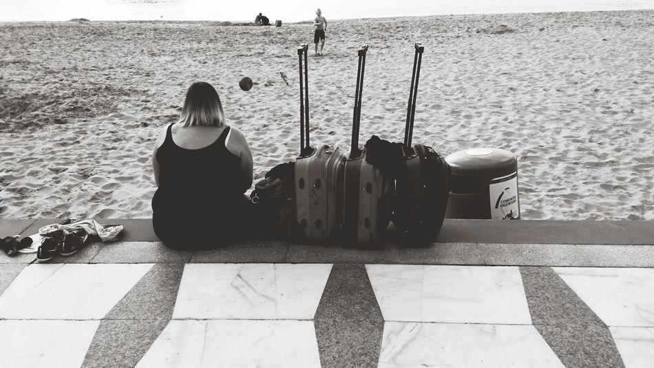Street Photography the Girl and her Luggage Trolleys Benidorm