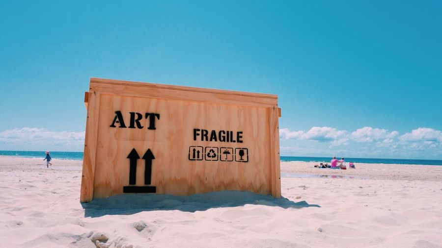 Beach Sea Text Western Script Water Tranquil Scene Blue Sky Sand Communication Shore Tranquility Scenics Cloud Vacations Remote Lifeguard  Outdoors Day Nature Art Box Freight