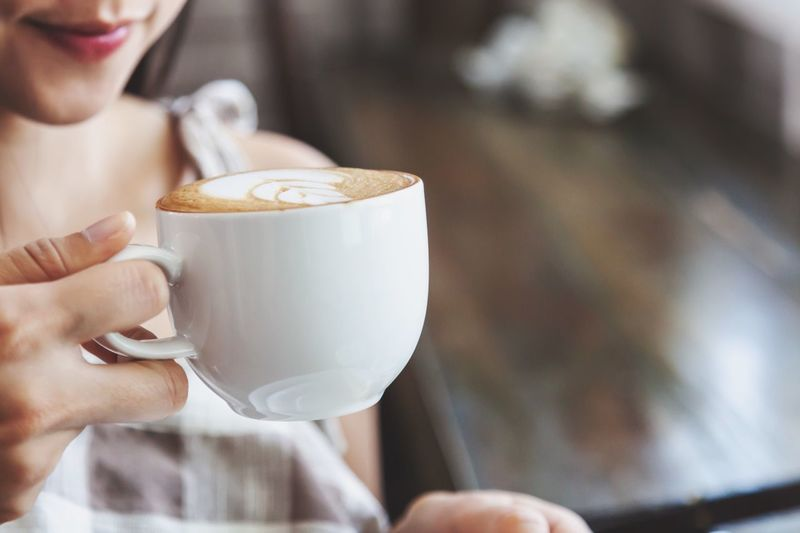 Woman drinking coffee Food And Drink Cup Mug Drink Coffee - Drink Coffee Refreshment Hot Drink Holding Coffee Cup One Person Hand Women Cappuccino Frothy Drink Focus On Foreground Human Hand Freshness