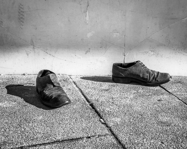 Shoes Black And White Street Still Life Street Photography Shoes Land Day No People Outdoors Shoe Abandoned Shadow Still Life Footpath Concrete