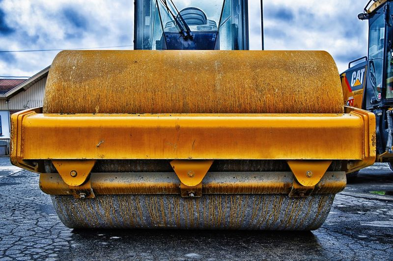 Yellow Transportation Mode Of Transportation Day Land Vehicle No People Street Cloud - Sky Sky City Outdoors Machinery Close-up Road Industry Construction Industry Construction Machinery Construction Site Nature Focus On Foreground Construction Equipment