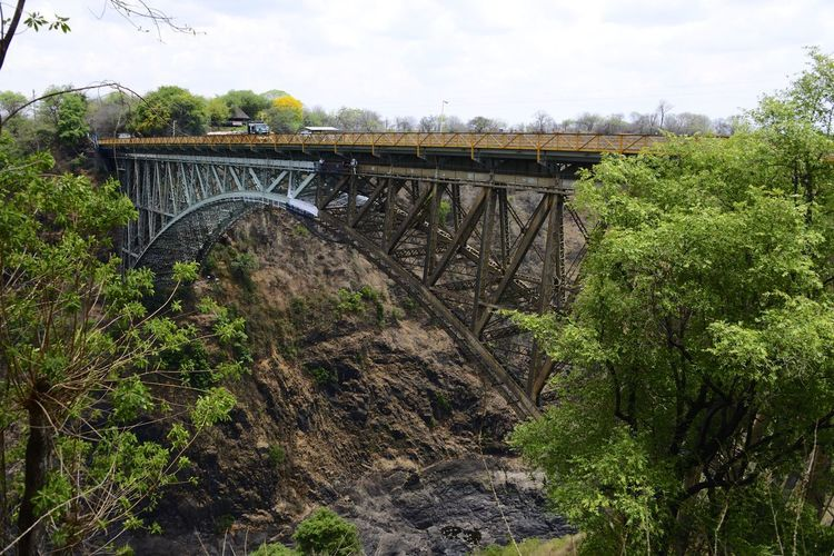 Victoria Falls Zimbabwe Border Crossing PaintJob Zimbabwe Arch Architecture Border Bridge - Man Made Structure Built Structure Connection Day No People Outdoors Transportation Victoria Falls Victoria Falls Bridge