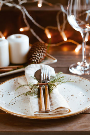 Table Food And Drink Plate Food No People Indoors  Still Life Eating Utensil Fork Candle Kitchen Utensil Glass Close-up Freshness Wood - Material Setting Selective Focus Place Setting Household Equipment Drink Table Knife Crockery Holiday Moments