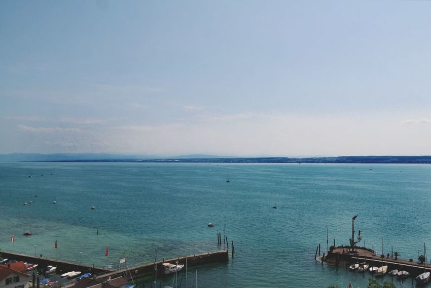 Bodensee - three colors blue Bodensee Meersburg Horizon Over Water Blue Blue Sky Nature Photography Beauty In Nature Sailing Ship Water Nautical Vessel Sea Beach Horizon Sky Commercial Dock Sailboat Harbor Marina