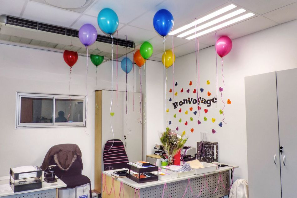 Last Day at the Office Balloons Bon Voyage Farewell Office Desk Colored Balloons Various Colors Workplace A New Beginning