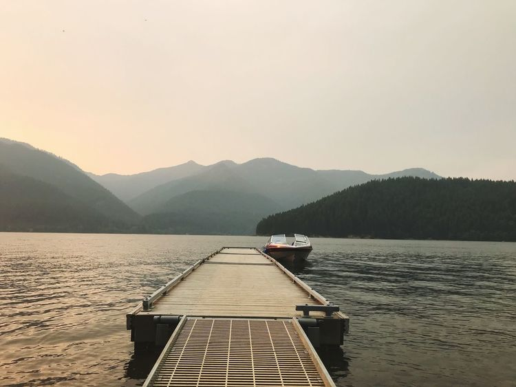 Simple Dock Boat Dock Dock Boat Water Tranquility Mountain Tranquil Scene Scenics Nature Lake Outdoors No People Day Sky Beauty In Nature Mountain Range