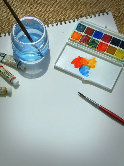 Watercolour setup. Watercolor Pallette Watercolour Brush Art Painting Painting Artwork Painting Theme Watercolour Painting Colour Pallete Paint Tubes Water Jar Watercolour Pad Art Offset Art Copy Space Art Theme