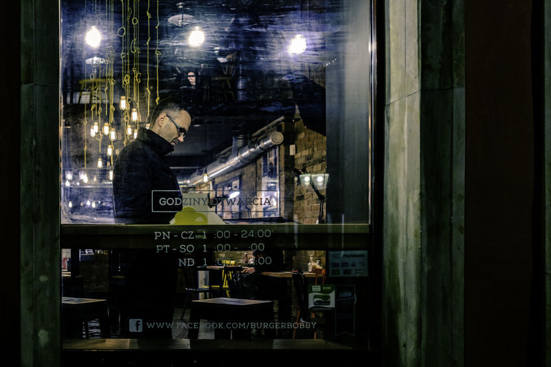 Waiting for an order. [37/365] 2016.11.15 Since today I was fully consumed by the errands during the day, I only managed to have some little time for a short, late evening, stroll down the Długa street in Gdańsk's Old Town. Bar Bulbs Candid City Glass Glasses Illuminated Indoors  Lifestyles Man Moment Negative Space Night One Man Only One Person People Portrait Restaurant Storefront Street Street Photography Streetphotography Urban Waiting Window
