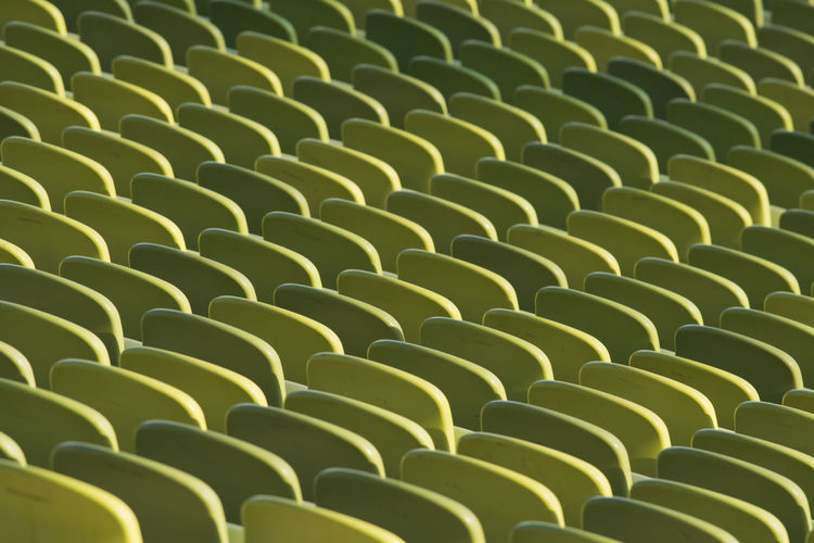 Full frame shot of green empty chairs