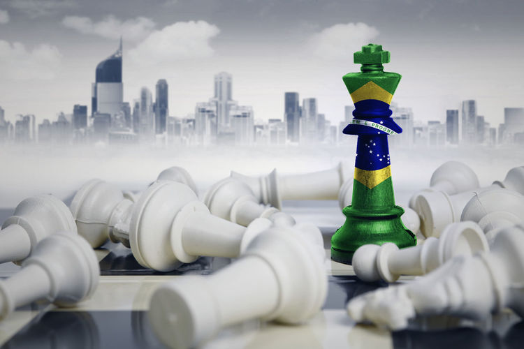 Close-up of chess pieces against buildings in city