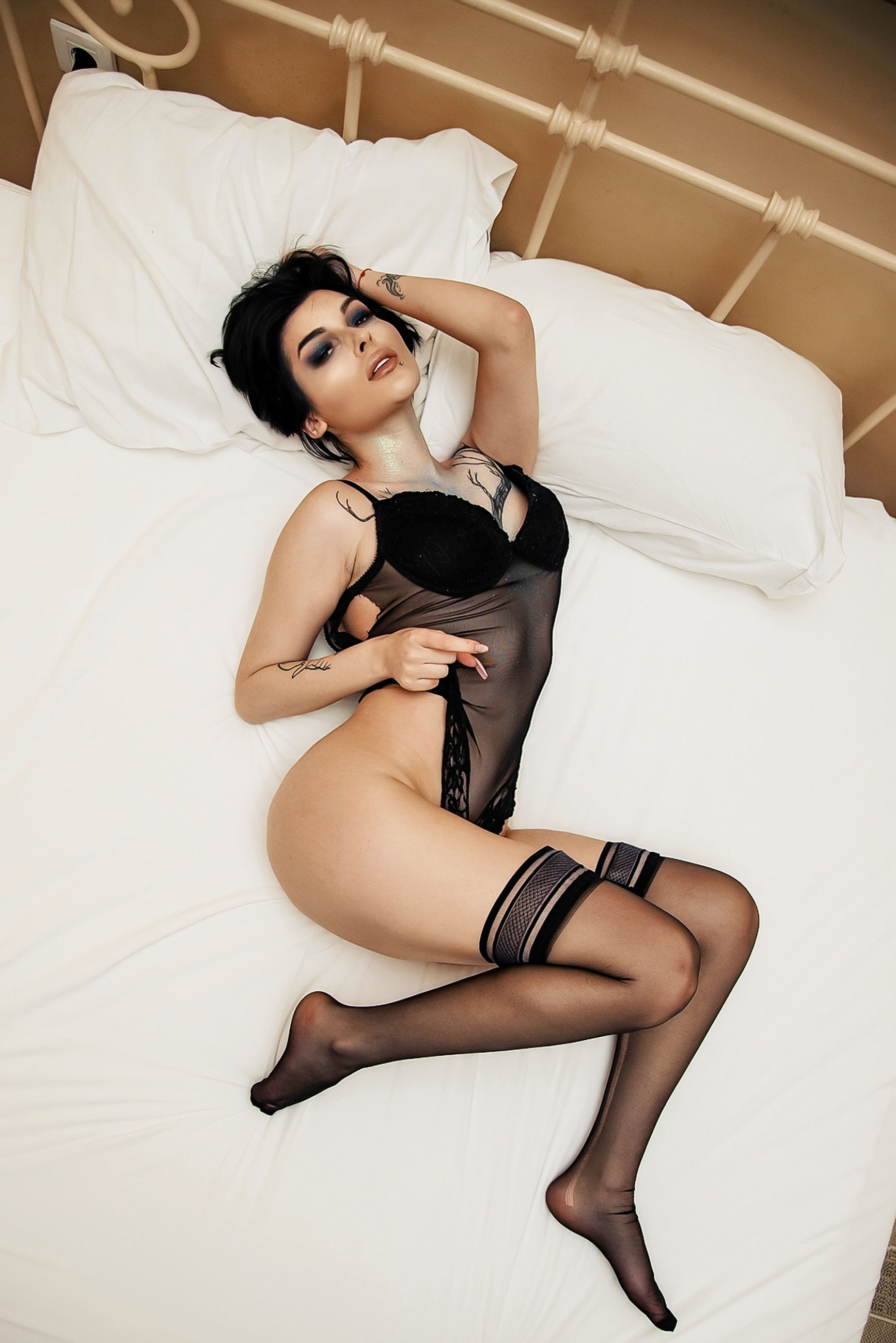 adult, women, one person, young adult, bed, indoors, black hair, clothing, fashion, full length, furniture, portrait, domestic room, limb, bedroom, human leg, underwear, undergarment, lifestyles, female, hairstyle, looking at camera, lying down, lingerie, relaxation, brown hair, long hair, desire, photo shoot, high heels, black, glamour, elegance, shoe, human hair