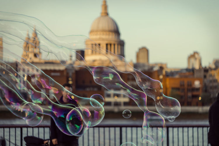 Bubbles against cathedral in city