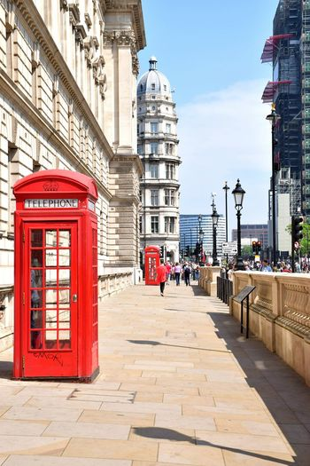 Telephone booth footpath in city