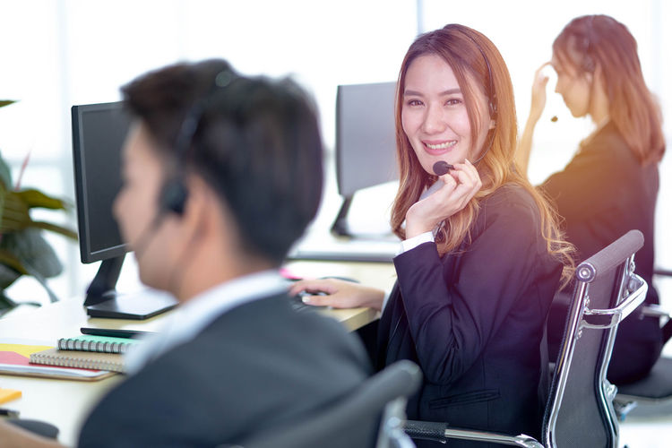 Portrait of customer service representative working in call center
