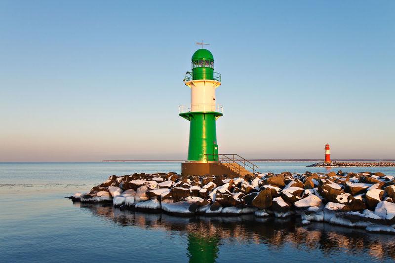 Lighthouse at calm blue sea