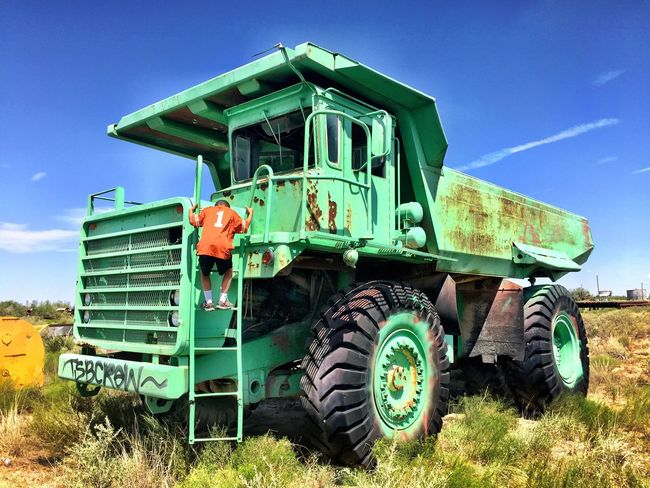 Field Industrial Equipment Blue Sky Massive Climbing Sky Outdoors Green Color Rural Scene Land Vehicle No People Blue Day Landscape Grass Nature Dump Truck