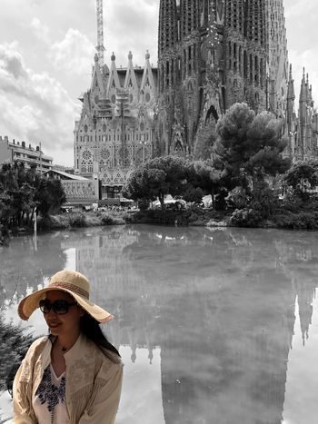 Sagrada Familia Architecture_collection Streetphotography Gaudi Gaudì Architecture Work Sagrada Familia Colorsplash_theworld Colorsplash EyeEm Gallery Eye4photography  IPhoneography Iphoneonly Iphonephotography Reflection Building Exterior Architecture One Person Water Built Structure Hat Real People Women Building